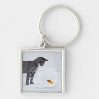 Curious cat watching goldfish in fishbowl keychain