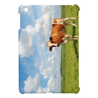 Curious cow standing on meadow. iPad mini cover