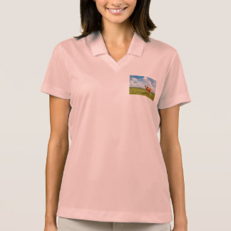 Curious cow standing on meadow polo t-shirts