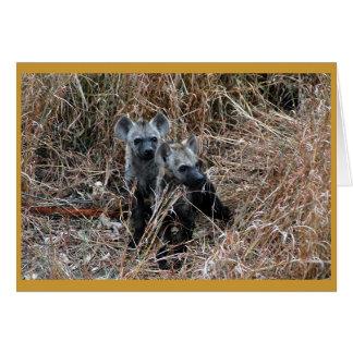 Curious hyena pups. greeting card