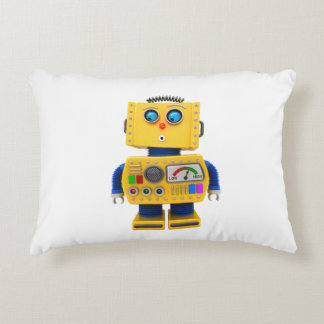 Curious toy robot looking down decorative pillow