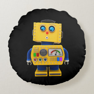 Curious toy robot looking down round pillow