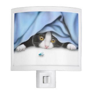 Curious Tuxedo Kitten with Bug Night Light