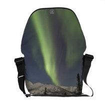 Curtains of aurora borealis dance across the sky courier bag
