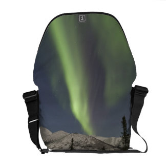 Curtains of aurora borealis dance across the sky courier bag