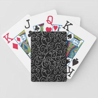 Curvas blancas del movimiento en sentido vertical baraja cartas de poker