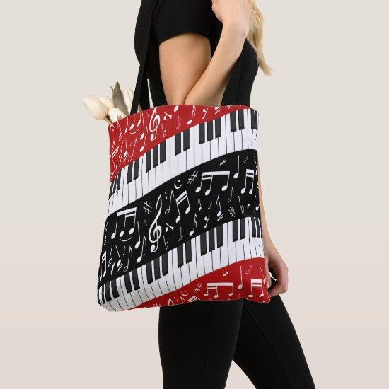 Curve piano keys and musical notes tote bag