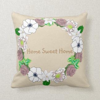 Cushion featuring a floral wreath