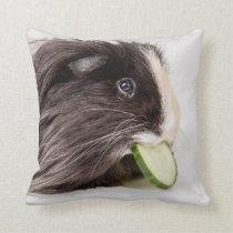 Cushion with cute guinea pig eating cucumber
