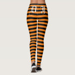 "Custom black and orange Halloween party leggings<br><div class=""desc"">Custom black and orange stripe Halloween party leggings. Trendy holiday clothing for women and teen girls. Personalizable bold striped tights with custom color background and monogram letter template. Make your own custom printed pants for costume party, fashion shoot, workout, gymnastics, dance, gym, fitness, work out training, yoga, jogging, figure skating,...</div>"