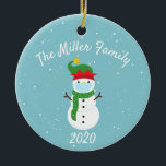 """Custom Christmas Face Mask Snowman 2020 Ceramic Ornament<br><div class=""""desc"""">This design was created though digital art. It may be personalized in the area provided or customizing by changing the photo or added your own words. Contact me at colorflowcreations@gmail.com if you with to have this design on another product. Purchase my original abstract acrylic painting for sale at www.etsy.com/shop/colorflowart. See...</div>"""