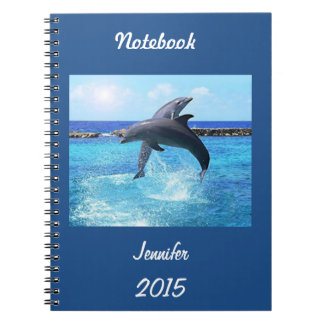 Custom dolphins playing in the ocean doing tricks notebook