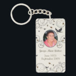 "Custom Flowers and Swirls Memorial Keepsakes Poem Keychain<br><div class=""desc"">Capture your heartfelt thoughts and feelings about your departed loved one with Custom Memorial Keepsakes. With a funeral poem: &quot;God saw you getting tired and a cure was not to be so he put his arms around you and whispered, &quot;Come to Me&quot; With tearful eyes we watched you and saw...</div>"