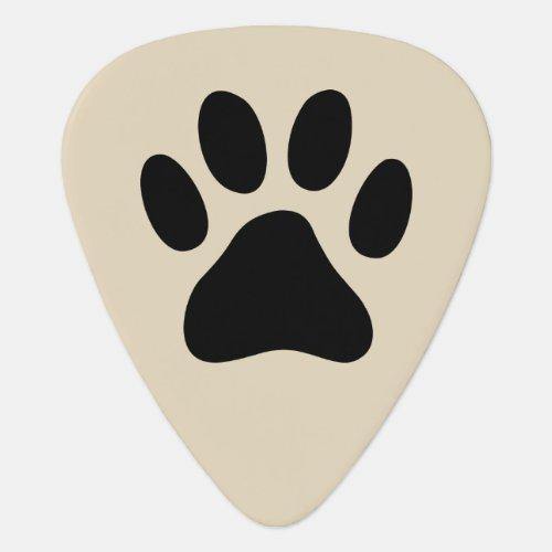 Custom guitar pick with dog paw footprints