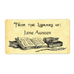 """Custom &quot;Library Of&quot; Vintage Books Label<br><div class=""""desc"""">A custom bookplate reading From the Library of in an arts and crafts style script with room for your own name in blocky letters on a faux parchment background, and a row of vintage books with a writing quill, in an antique etched art style. Customize it to change fonts, sizing...</div>"""