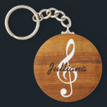 "custom musical note on wood keychain<br><div class=""desc"">Personalizable treble clef music note on faux wood grain impression</div>"
