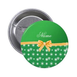 Custom name green snowflakes gold bow pinback button