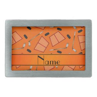 Custom name orange hockey sticks pucks nets belt buckle