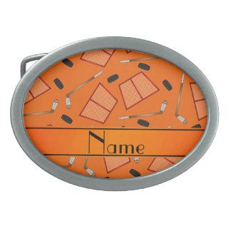 Custom name orange hockey sticks pucks nets oval belt buckle