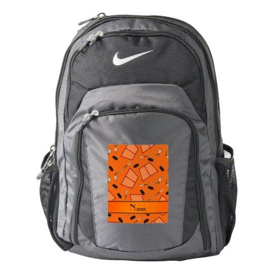 Custom name orange hockey sticks pucks nets nike backpack