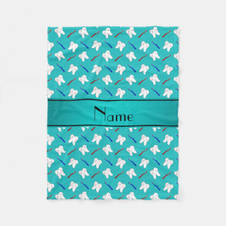 Custom name turquoise brushes and tooth pattern fleece blanket