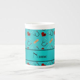 Custom name turquoise stethoscope bandage heart bone china mugs