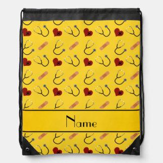 Custom name yellow stethoscope bandage heart drawstring backpacks
