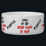 "Custom Named Corgi Dog Zombie Joke Food Bowl<br><div class=""desc"">This bloody text design is perfect for any Corgi dog who is a Corgi by day but a zombie slayer by night,  very funny especially when you add their own name.</div>"