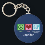 "Custom Speech Language Pathology Keychain<br><div class=""desc"">Cute personalized speech therapist keychain gift. Peace love and speech language pathology on dark blue background with your SLP&#39;s name. A great speech language pathologist gift.</div>"
