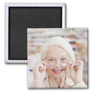 Customer trying in prescription eyeglasses in 2 inch square magnet