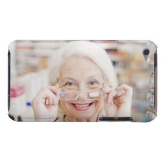Customer trying in prescription eyeglasses in barely there iPod case