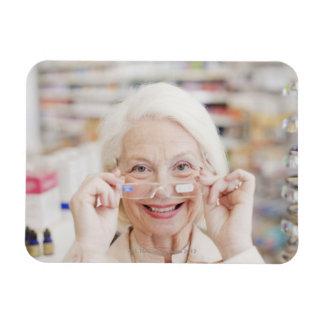 Customer trying in prescription eyeglasses in rectangular photo magnet