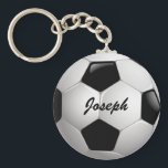 "Customizable Football Soccer Ball Keychain<br><div class=""desc"">Soccer sports design with a close up image of a soccer ball, fully customizable with your own name or text. Perfect for the soccer player, football fan or soccer coach. Other color combinations are available in our store and we welcome custom requests, just contact us through our GiftsBonanza store prior...</div>"