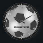 """Customizable Silver Soccer Ball Large Clock<br><div class=""""desc"""">Silver Soccer ball design fully customizable with your own name or text. Ideal for name tags for soccer parties or soccer teams or as a special gift for that young soccer player in your life. sgb01</div>"""