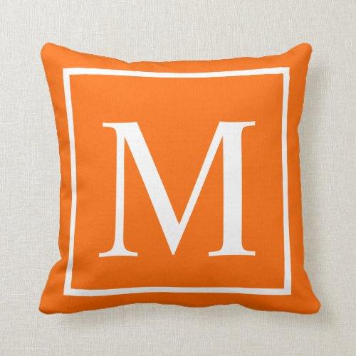 Customize monogram on bright orange throw pillow