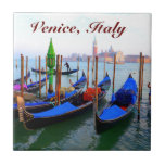 "Customized Image of Gondolas in Venice Tile<br><div class=""desc"">Gondolier returning to dock his gondola at the shore on the Giudecca Canal in Sestiere San Marco,  from  Venice,  Italy. Customize this picture with a personal message!</div>"