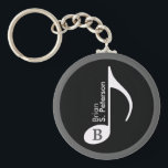 "customized musical note keychain<br><div class=""desc"">Simple black and white design about music. A graphic music-symbol in a circle,  to personalize with name and initial-letter</div>"