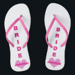 "Customized Pink Heart Bride Flip Flops<br><div class=""desc"">Your bride will love a pair of pink heart flip flops customized with her name.</div>"