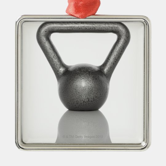 Cut out of a kettle bell on white background metal ornament