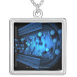Cut view of blood cells in an artery pendant
