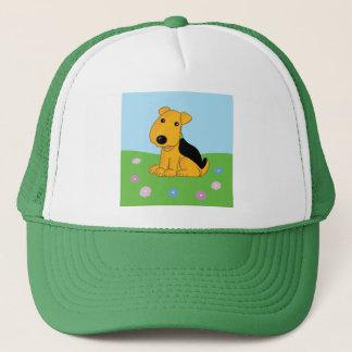 Cute Airedale Puppy Dog in Field Trucker Hat