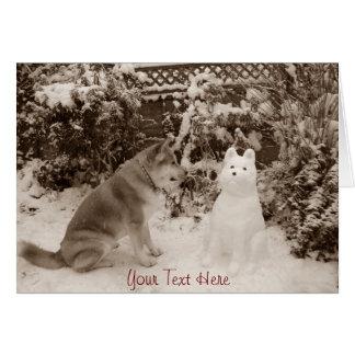 cute akita in the snow with a snowman akita photo card