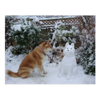 cute akita sitting in snow with snowman dog photo postcard