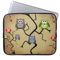 Cute and colorful owls on laptop sleeve
