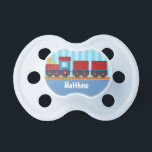 """Cute and Colourful Train for Newborn Baby Boy Pacifier<br><div class=""""desc"""">An adorable,  attractive and colourful illustration of a yellow,  red and blue train carrying cargo for newborn baby boys. Light blue vertical stripes background. Personalise easily with boy&#39;s name. Great little gift for newborns for baby showers.</div>"""