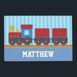 """Cute and Colourful Train with Cargo for Boys Placemat<br><div class=""""desc"""">Keep your boys at the dining table with this adorable,  attractive and colourful illustration of a yellow,  red and blue train tolling along cargo on a railway track. Light blue vertical stripes as background. Personalise easily with boy&#39;s name.</div>"""