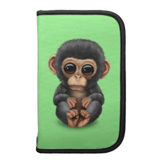 Cute and Curious Baby Chimpanzee on Green Folio Planners
