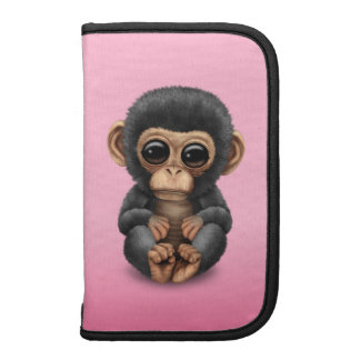 Cute and Curious Baby Chimpanzee on Pink Planner