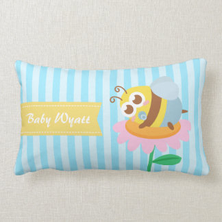 Cute baby bee resting on a pink flower pillows
