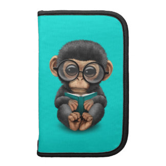 Cute Baby Chimpanzee Reading a Book on Blue Folio Planners